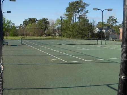 Tennis courts, next to pool